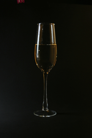 Glasses with white wine on black background. you can place your text Stock Photo