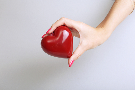 heartache: Female doctor hold in hands red heart . Cardio therapeutist, student education, arrhythmia concept