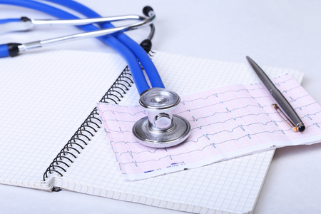 diagnose: Folder file, stethoscope and RX prescription on the desk. blurred background. Stock Photo