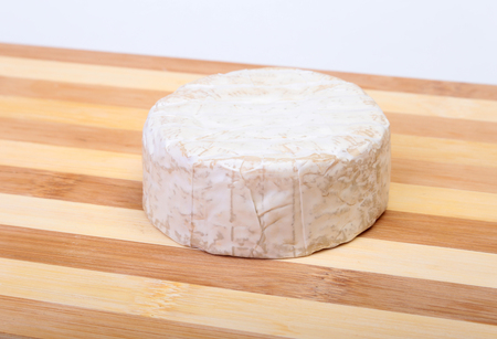 Cheese with white mold. Camembert or brie type on wood table. Healthy breakfast. Stock Photo
