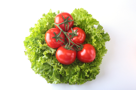Fresh assorted vegetables with leaf lettuce. Isolated on white background. Selective focus.