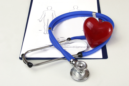 RX prescription, stethoscope, pils and red heart on white background. Stock Photo