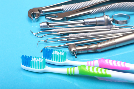 dental care toothbrush with dentist tools on mirror background. Selective focus.