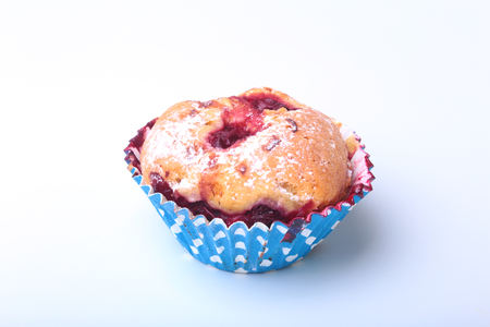 blueberry muffin: Homemade Blueberry muffins with powdered sugar and fresh berries. Stock Photo