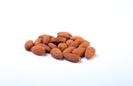 nuts almonds isolated on white background. Selective focus.