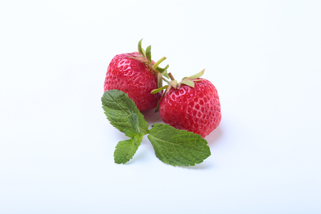 Fresh strawberries and mint leaves isolated on white background. Selective focus Stock Photo
