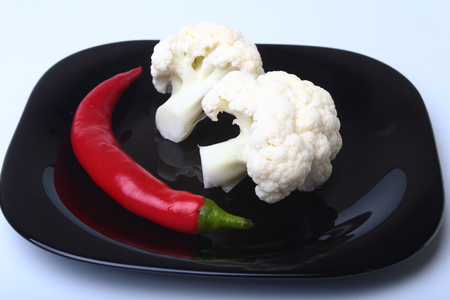 cutouts: fresh cauliflower on black plate. Ready for cooking. Stock Photo