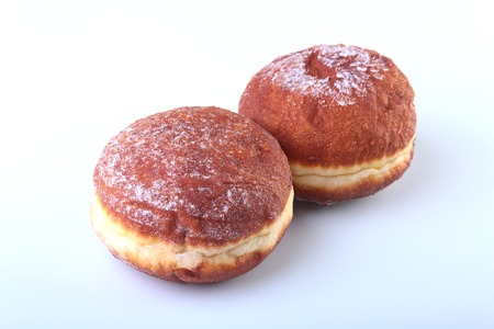 croatian: Homemade Doughnuts with Jelly filled and powdered sugar isolated on white background. Selective focus.