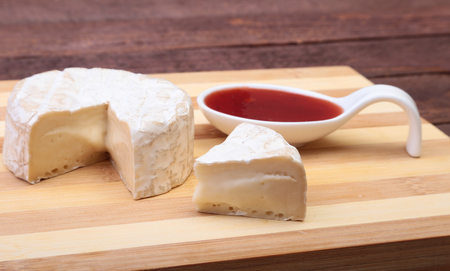 Cheese with white mold. Camembert or brie type with Cranberry sauce.. Healthy breakfast. Stock Photo