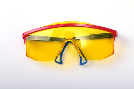 safety glasses for work. Eye protection during operation on a white background .
