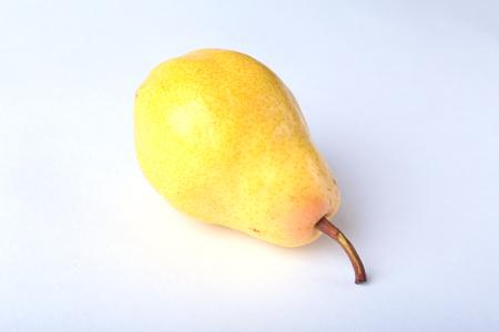 Fresh organic pear isolated on white bacground.