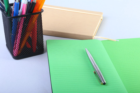 Colorful notebooks and office supplies on white table. Stock Photo