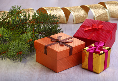 Christmas decoration with gift boxes and christmas tree on a blurry, sparkling and fabulous background. Stock Photo