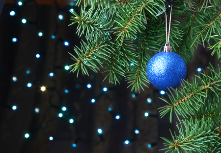 Decorated with christmas balls Christmas tree on a blurry, sparkling and fabulous background. Banque d'images