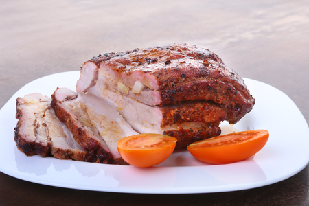 grilled pork chops with tomato and ketchup on plate.
