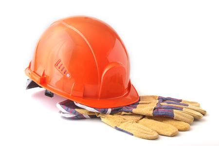 오렌지 하드 모자, 흰색 배경에 안전 장갑. 안전 헬멧.