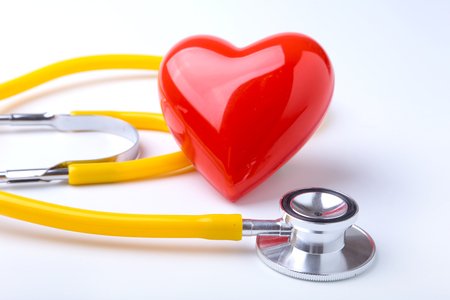 Red heart and a stethoscope on white background Stock Photo