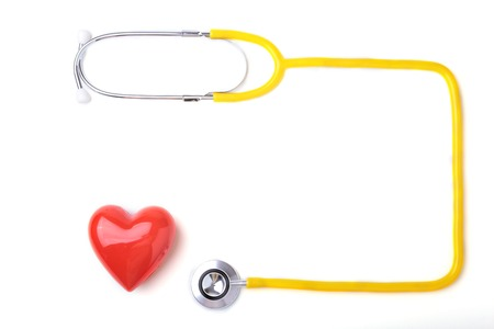 Red heart and a stethoscope on white background. Stock Photo