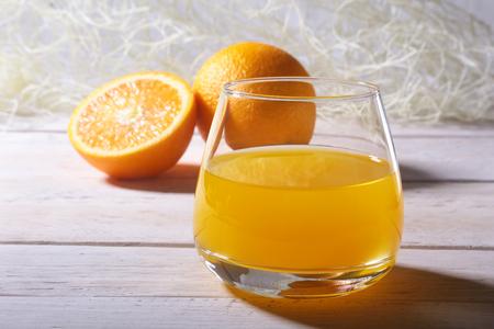 Orange and juice in glass. Morning breakfast. Stock Photo
