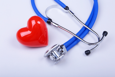 Stethoscope and red heart on white table with space for text Stock Photo