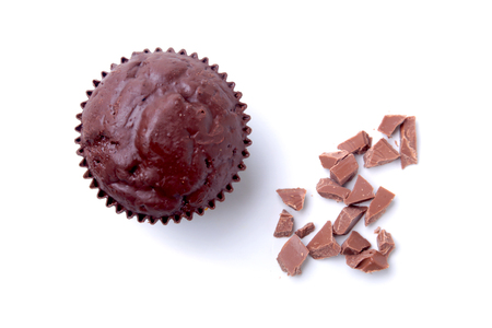 Delicious homemade cupcake with raisins and chocolate isolated on white background. Muffins. Top view.