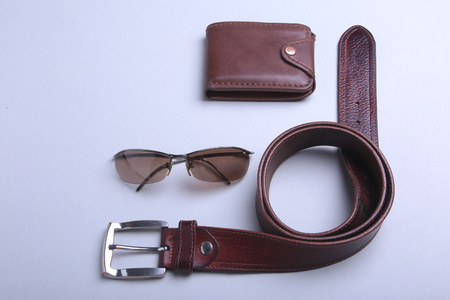 Mens accessories for business and rekreation. A professional studio photograph of mens business accessories. Top view composition Standard-Bild