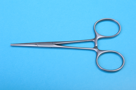 Close Up Surgical instruments and tools on blue mirror background. Selective focus. Stock fotó