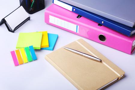 Folder file, note and pen on the desk. blurred background. 版權商用圖片