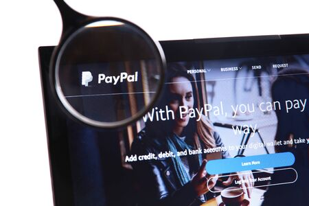 New York, USA - March 25, 2019: Illustrative Editorial of Website of Paypal visible on display screen. Paypal is an American online payment and banking company. Editoriali