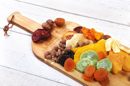 Vacaville Fruit Co. Inc, CA - April 01, 2019. Premium fruit and nuts bamboo wine board. Illustrative Editorial.