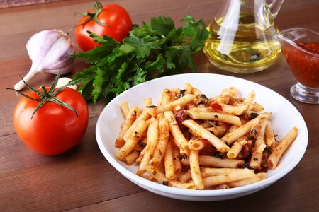 Spicy pasta penne bolognese with vegetables, chili and cheese in tomato sauce. Stock fotó