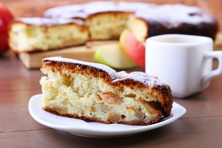Classic American apple pie. Piece of tasty Organic Apple Pie and cup with espresso coffee. Dessert Ready to Eat. Stockfoto