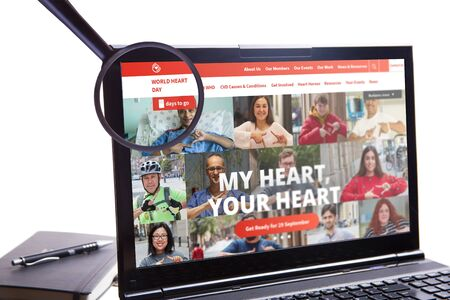 New York, USA - September 10, 2019: An illustrative Editorial of the World Federation of Heart website is visible on the display screen. World Heart Day Text is visible in a magnifying glass.