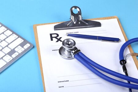 Medical stethoscope lying on cardiogram chart closeup. Medical help, prophylaxis, disease prevention or insurance concept. Cardiology care Stock Photo