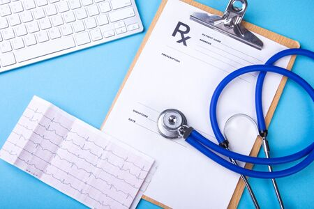 Medical stethoscope lying on cardiogram chart. Medical help, prophylaxis, disease prevention or insurance concept. Cardiology care. Top View Stock Photo