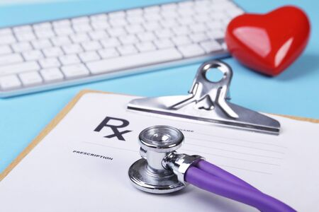 Red heart, keyboard and Medical stethoscope lying on cardiogram chart closeup. Medical help, prophylaxis, disease prevention or insurance concept. Cardiology care Stockfoto