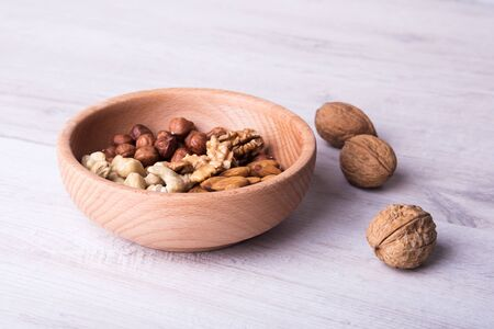 wood serving spoon with Assortment nuts on wooden table. Close-up. Archivio Fotografico