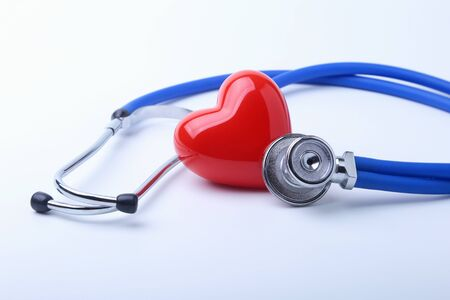 Medical stethoscope and red heart isolated on white Archivio Fotografico
