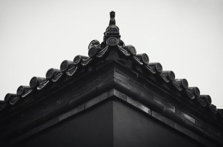 Ancient Chinese wall decorated with glazed roof tiles