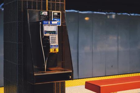 Public phone installed on subway pillar