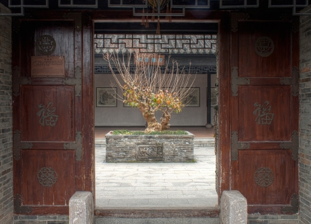 chinese courtyard: Courtyard Entrance Doors in The Chinese Garden Editorial