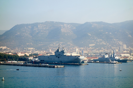 Port with a warship on the French Blue Coast