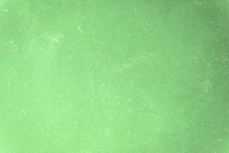 A grainy background of a green color