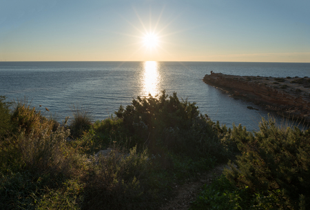 The red ibiza creek at dawn, baleares, Spain 스톡 콘텐츠