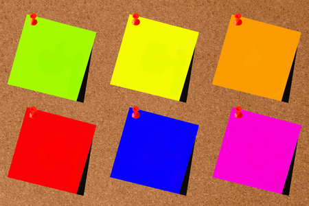 Green, blue, yellow, red, orange and pink paper with brown slate background