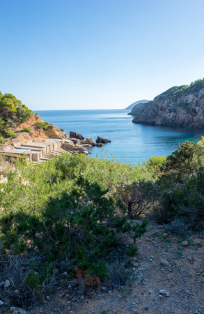 The cove will be with blue water on the island of Ibiza, Spain