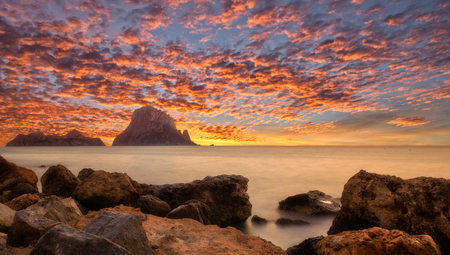 Sunset in Ibiza next to the island of Es vedra, Spain
