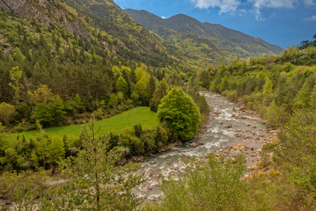 The river in broto with the blue sky, pyrenees, ordesa, Spain Imagens