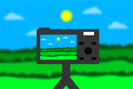 A photo camera photographing a beautiful green landscape