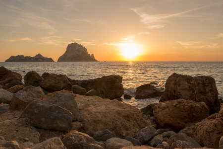 The sunset on the island of Es vedra, Ibiza, Spain